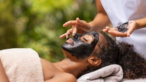 woman with face mask from activated charcoal hacks